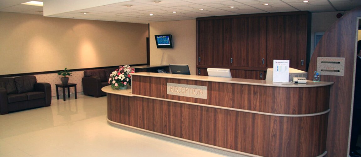 Bespoke Curved Hotel Reception Desks Elegant Wooden