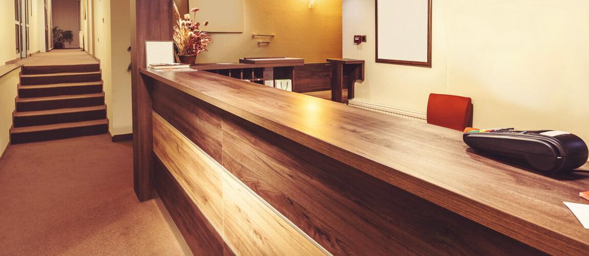 Bespoke Hotel Reception Desk In 2 Tones Of Wood